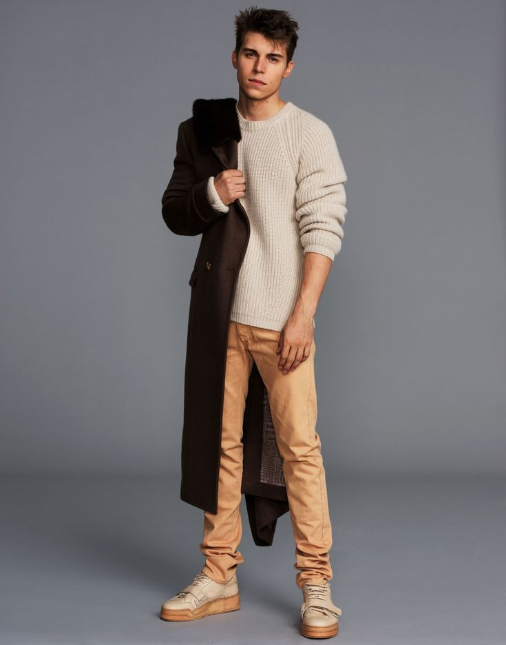 Nolan Funk standing with one arm in his coat