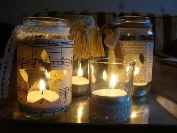 empty jars , music sheets, lace details and there is pretty canlde holder!
