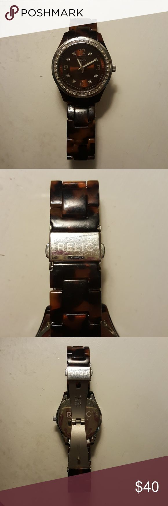 Relic Brown Tortoise Shell Watch Beautiful tortoise shell watch with crystals around the face. Minor scratches from wear, no marks on the face. Needs a new battery. No links have been removed. Relic Accessories Watches