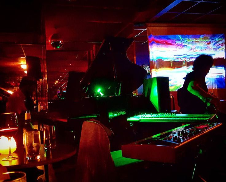 At Vito's you half expect to see Don Draper walk in with two fur-clad ladies on his arms. Instead there are two men in cheap suits blocking your way to the restroom. #saturdaynight #nightlife #freestuff #afrocop #psychedelic #jazz #bar #midcentury #lights #piano #keyboard #synth