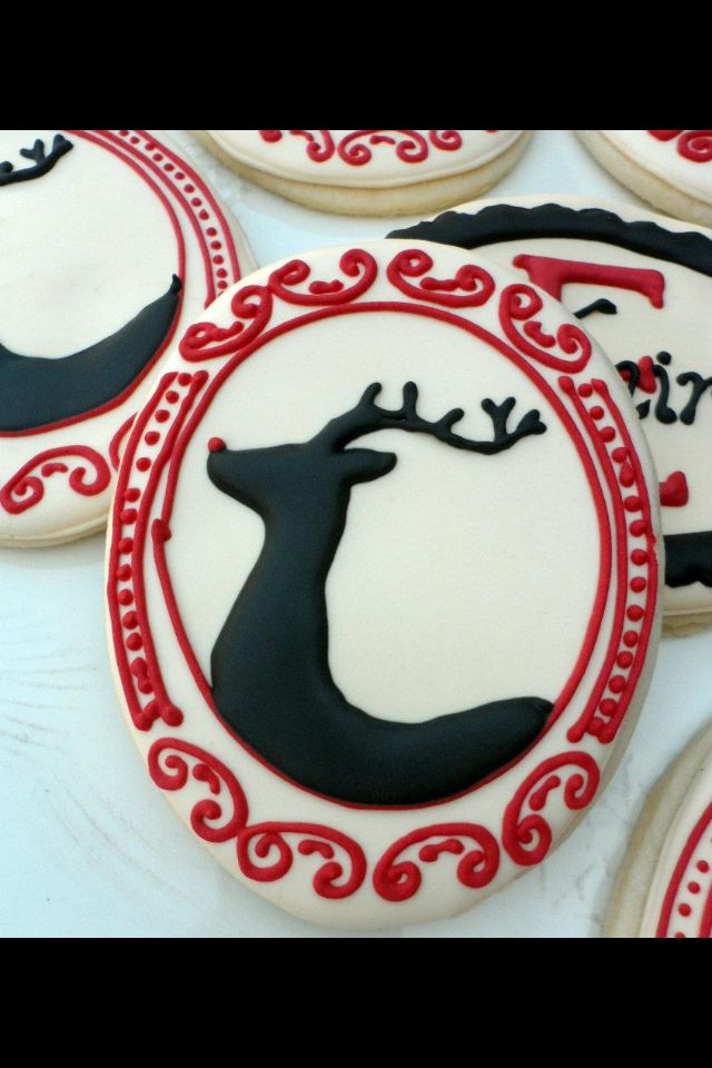 Christmas reindeer silhouette in red frame decorated cookie- cookie, frame, what have you