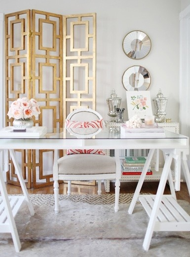 Pretty Office Space with Ikea Trestles Desk and Gold Room Divider.