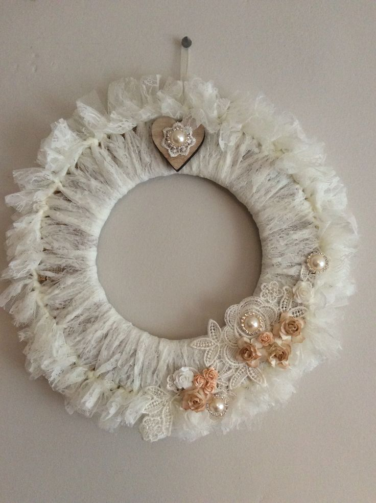 Handmade shabby chic Winter inspired white lace wreath with lace appliqué and flowers.
