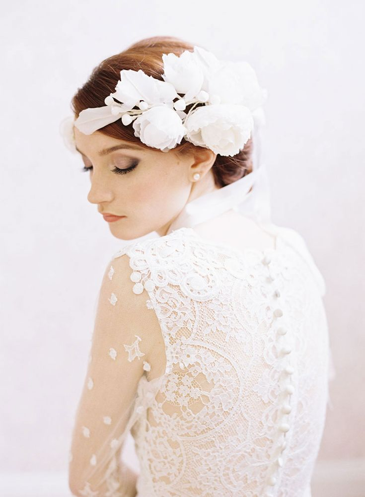 bridal floral headpiece by erica elizabeth. vintage lace wedding gown by claire pettibone (lily). photography by caroline tran.