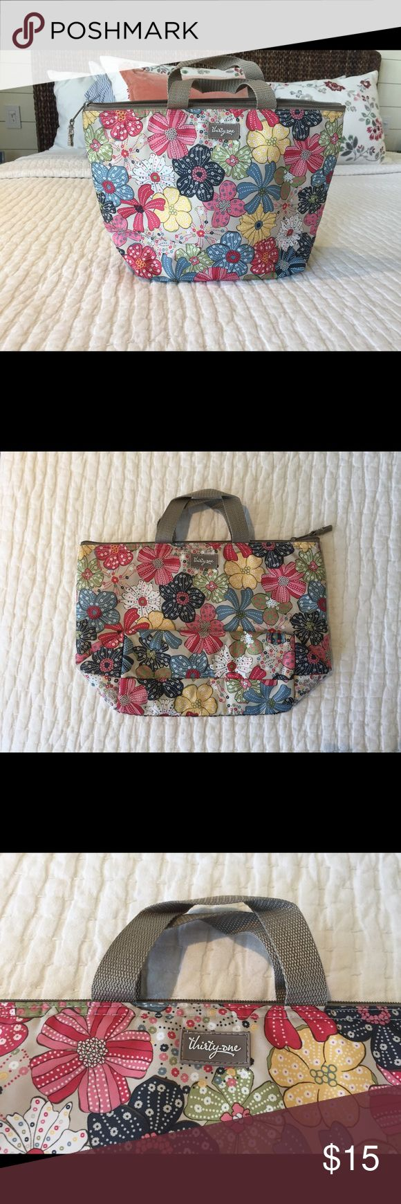 Thirty-one Lunch Bag Thirty-one insulted lunch bag. Adorable Floral print. Slight flaw on the interior, and two small holes on the bottom back corners of the bag. Flaws shown in picture. Does not at all affect the use of the bag. Smoke and pet free home! Thirty-one Bags