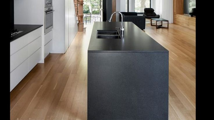 My kitchen inspiration Mine will be a low matt anthracite or charcoal coloured L shaped ( with 90cm drawers) peninsula, open to the lounge.  At the far end of the kitchen a wall of 6, floor to ceiling units in white (Ice or brilliant white) painted gloss. The floor to ceiling wall units will have integrated Miele Fridge freezer and 2 side by side ovens. 2 sleek black pendulous ceiling  lamps and 3 to 4 white ceiling spot lights