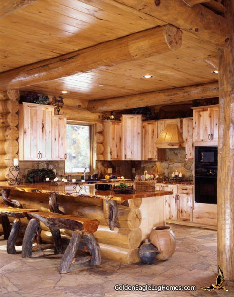 One of the most creative things you can do with a log home is to use natural wood elements in interesting places in your home. Here the homeowner used twisted log knuckles for counter top supports. They also use split log benches with massive log legs. The counter top is a two inch thick all wood counter top with wavy edges.
