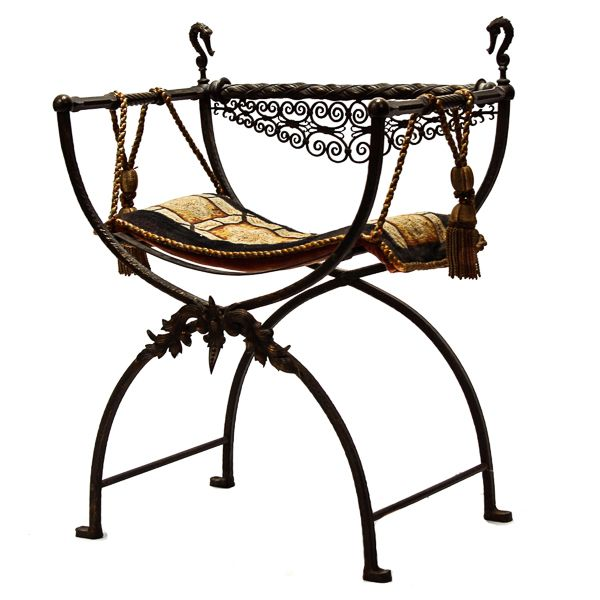 Style of Oscar Bach iron and bronze campaign chair with sea serpent / seahorse finials;