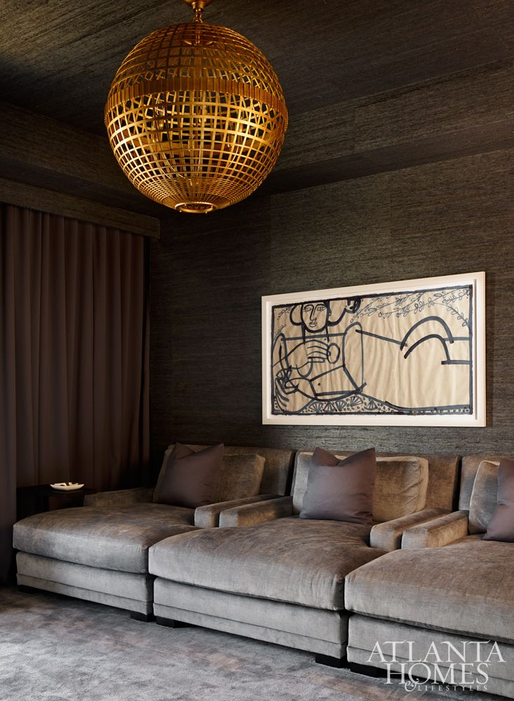 The television room exudes a cocoon-like appeal. Loungers, Lee Industries. Light fixture, Aerin Lauder through Circa Lighting.