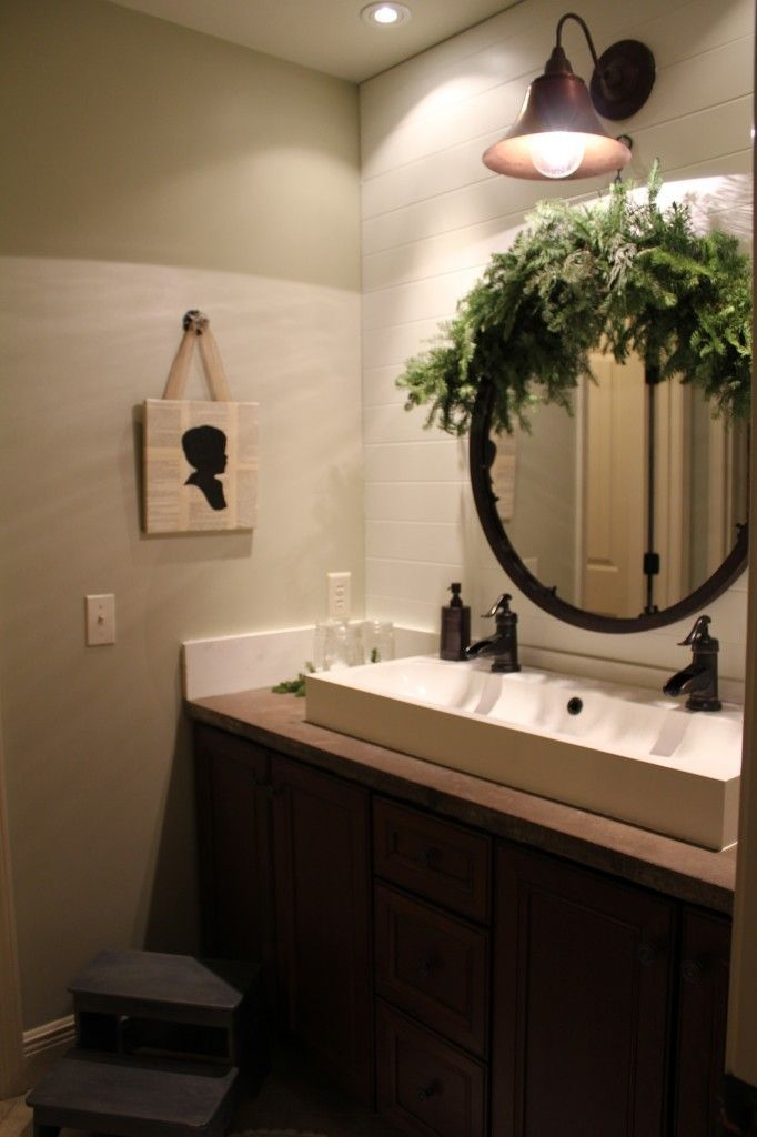 Even bathrooms can get in the holiday spirit! Add a little evergreen around the mirror and you have a classic holiday bathroom.
