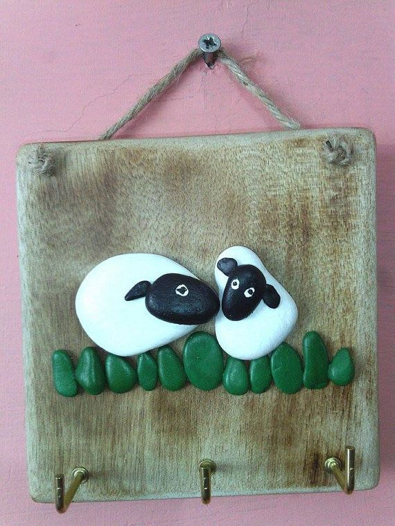 Cute Sheep in meadow, ready to hold on to your keys. Made from Welsh pebbles, painted with acrylic paint and set on a piece of recycled pallet