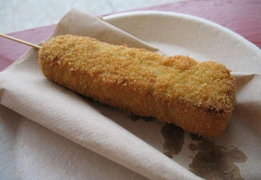 Nope...not a corn dog...it's a deep-fried Snickers bar! Fast becoming a fair food classic.