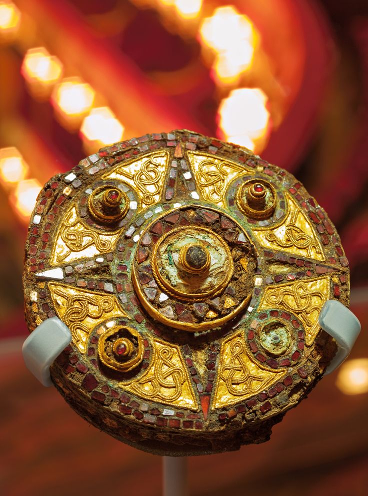 A seventh-century copper brooch, decorated with gold wire and a mosaic of garnets, once adorned the cloak of a high-born Saxon woman. Her grave was disturbed by workers building an extension to the Royal Opera House in Covent Garden.
