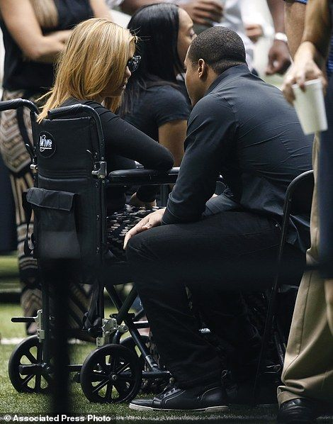 Racquel Smith, widow of former New Orleans Saints defensive end Will Smith, talks to former Saints running back Pierre Thomas, during a public viewing of Smith's casket inside the team's NFL football training facility in Metairie, La., Friday, April 15, 2016. Smith was shot to death, and Racquel wounded by gunfire, after an altercation following a traffic accident last Saturday. Thomas was with them when he was killed. (AP Photo/Gerald Herbert)