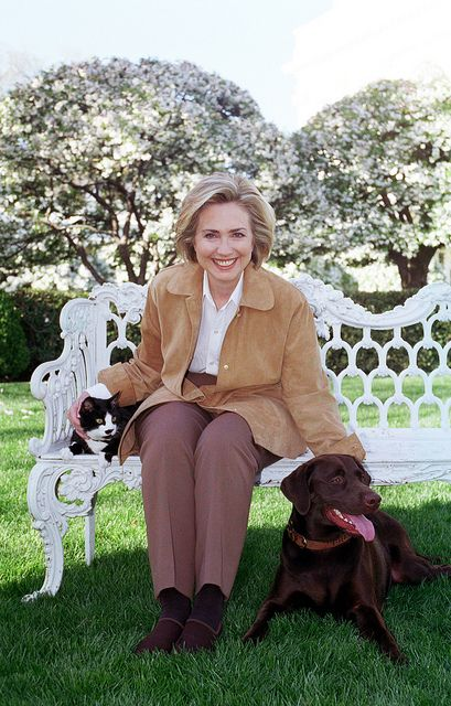 Photograph of First Lady Hillary Rodham Clinton with Socks the Cat and Buddy the Dog: 04/07/1999 by The U.S. National Archives, via Flickr