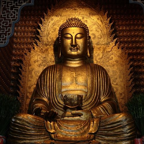 "the ""swastika"" or seal on Buddha's heart… The swastika used in Buddhist art and scripture is known as a manji (whirlwind), and represents Dharma, universal harmony, and the balance of opposites."