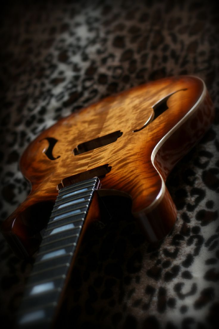 Flame birch top, spanish cedar body and neck.