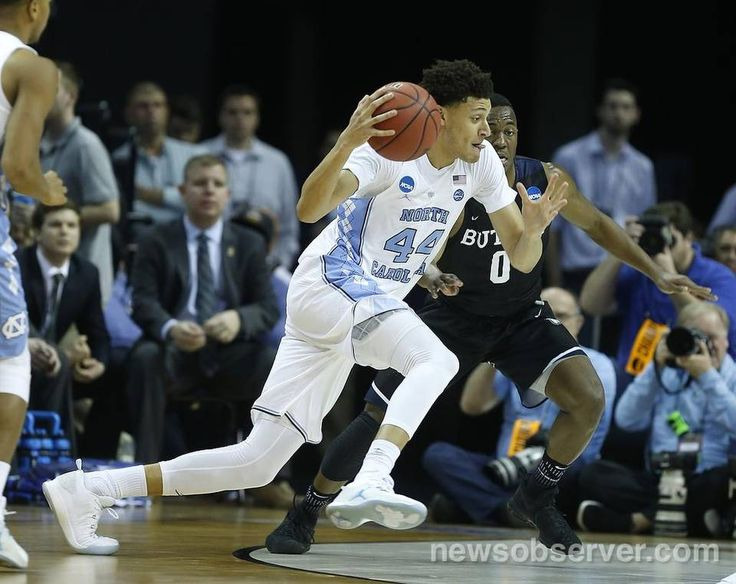 North Carolina's Justin Jackson (44) drives around Butler's Avery Woodson (0) during the first half of UNC's game against Butler in the NCAA Tournament South Regional semifinal at FedExForum in Memphis, TN Friday, March 24, 2017.