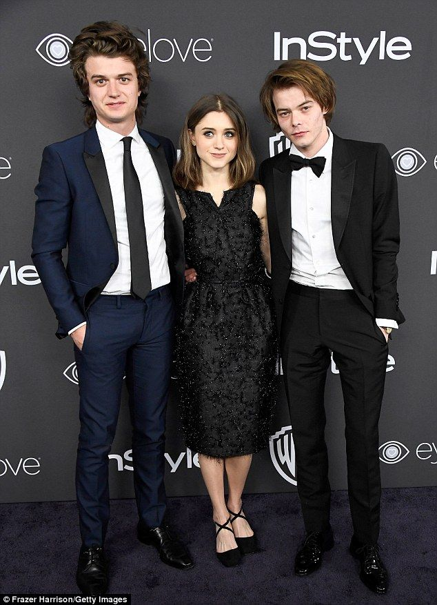 '[We] got really close': Fittingly, Heaton and Dyer third-wheeled it with castmate Joe Keery (who plays Steve) during Sunday night's Golden Globe festivities