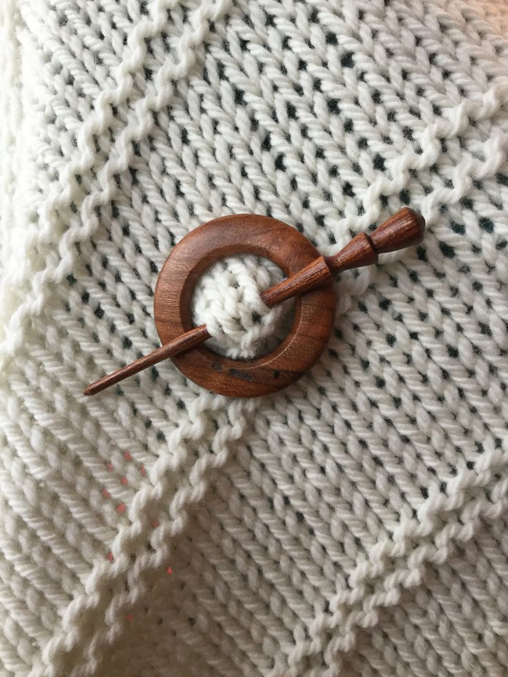 These beautiful shawl pins are hand turned by a wood worker in Massachusetts. Each one is unique. They are made from Cherry and Walnut burl. They range in size from 1.5 inches to 3 inches. They are th