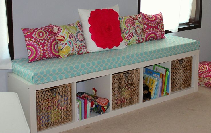 Turn a regular shelf sideways and add cushion... Cute sitting area/storage bench for kids' room! (CUTE BLOG!)