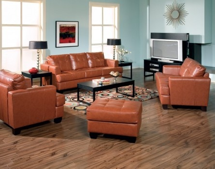 Have A Burnt Orange Sofa And Wood Floors And Am Trying To