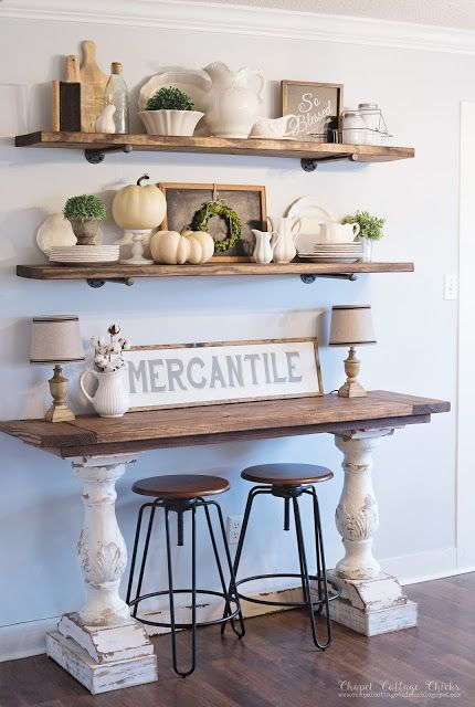 Thanksgiving decor - rustic farmhouse style shelves and console table with soft pale colors and white pumpkins