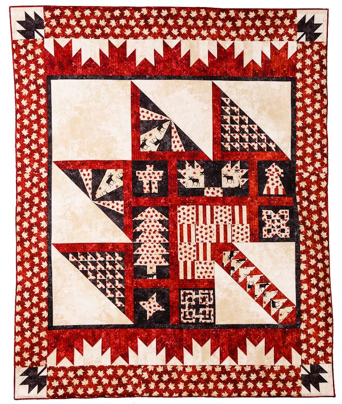 PURELY CANADIAN QUILT - I love the Delectable Mountains borders at the top and bottom.  Peace, Robert from Nancy's Fabrics.