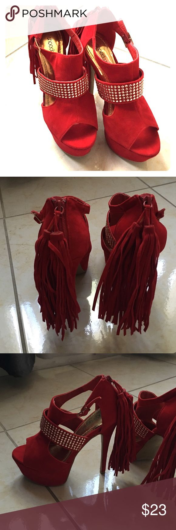 Red platform heels These are new never been worn red platform heels. They have a sparkly band in the center with tassels on the back. Shoe Dazzle Shoes Platforms