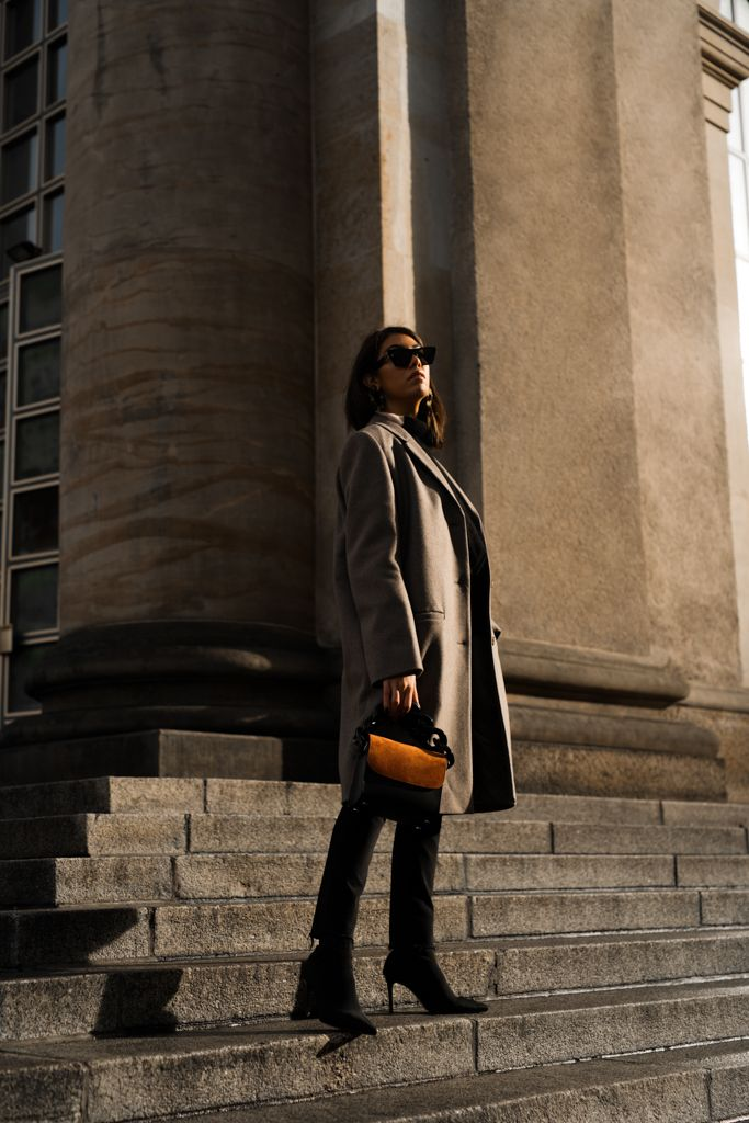STORM WEARS COS COAT WITH MARQUES ALMEIDA BAG AND CELINE SUNNIES