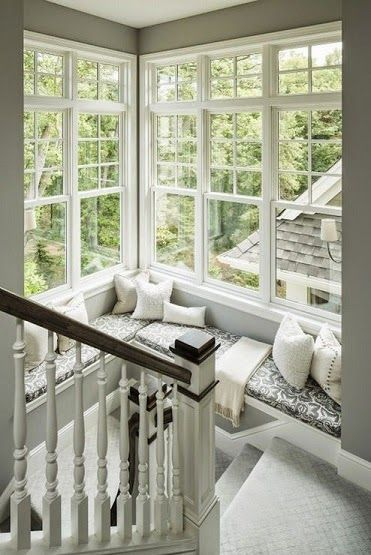 Love how this window seat on the stairs is framed by the windows - Wonderful Window Seats | http://homechanneltv.blogspot.com/2014/04/wonderful-window-seats.html #windowseats #interiordesign