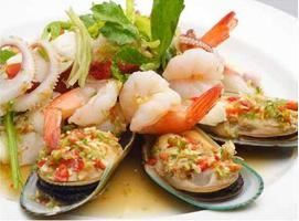 Seafood Salad :Assorted seafood with lettuce, onions flavored with spicy lime dressing from Pattaya Bay Restaurant in Los Angeles #Food #Salad #Restaurant forked.com