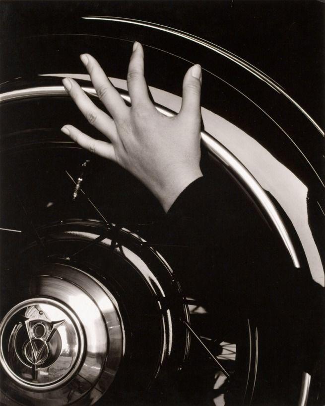 Alfred Steiglitz. [Georgia O'Keefe hand on back tire of Ford V8] 1933