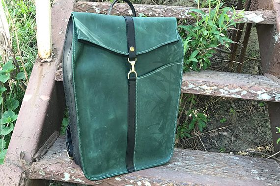 Backpack is stylish and practical will delight you with its originality! Authors backpack made by hand and everything is thought out to the smallest detail. Backpack is green with black leather elements. Backpack made of genuine leather. Backpack is very roomy and well holds its shape.