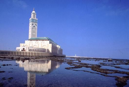 Hassan II Mosque, Casablanca, Morocco. 1986-93.  This mosque is the largest mosque in the country and the 7th largest in the world but lays claim to the worlds tallest minaret at 210 m. The mosque displays strong Moorish influence and the architecture of the building is similar to that of the Alhambra and the Great Mosque of Cordoba in Spain but infuses modern technology through heated floors, glass floors to view the ocean below and a retractable roof.