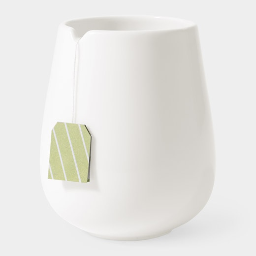 Luna Sao Tea Mug. Features a small indentation along the cup's rim that prevents the tea bag from falling in. A great gift.