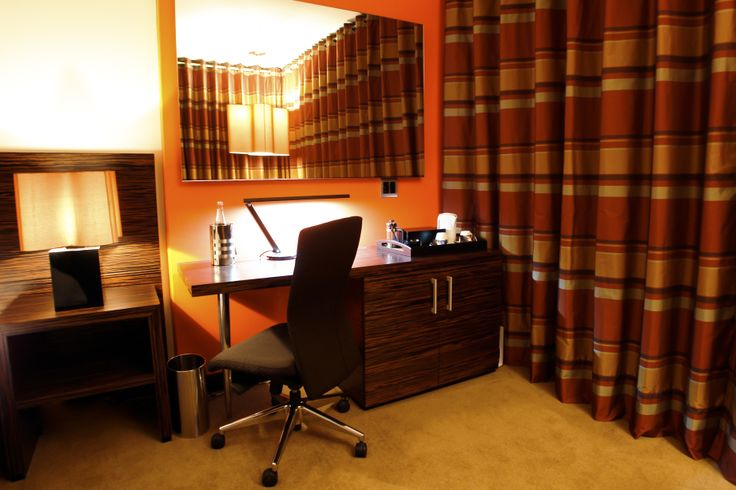 Luxury Workstation - Orange: These suites have large floor to ceiling windows overlooking the rolling landscape of the Klipriviersberg; they are located in the bush area of Thaba Ya Batswana ensuring quiet privacy. Each air-conditioned suite is equipped with large screen LCD television, and iPod docking station.