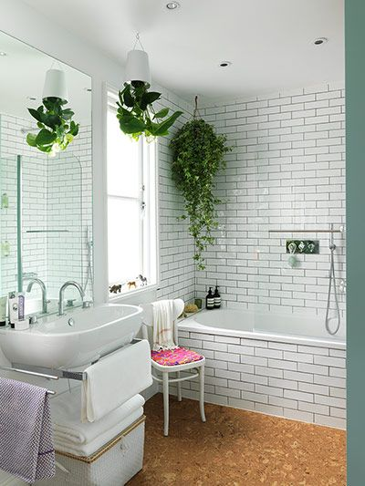 "Credit: Chris Tubbs ""I love my bathroom. It's my sanctuary,"" says Lulu. ""I wanted a tranquil, calm space that had lush greenery – a bit like..."