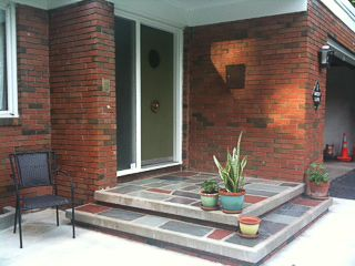 """Mid century inspired raised front porch  w/ different colored slate - really nice.  This would be good as an interior entrance to a """"sunk-in"""" living room, too, with all gray slate."""