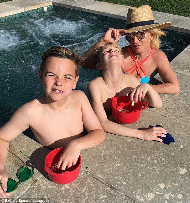 Bonding with her boys! Britney Spears enjoyed some 'family time' with her sons, Sean and Jayden, on Saturday. The swimsuit clad pop star shared a photo of their hot tub hang on IG