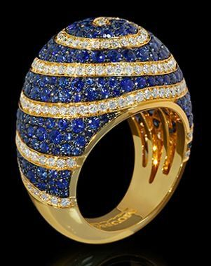 High domed gold ring covered in pave sapphires and diamonds.
