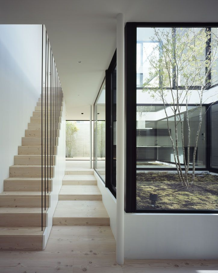 Adore the central courtyard - creating an atrium allowing light to penetrate the surrounding spaces on all levels.