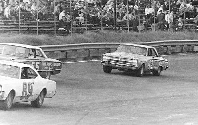Richard Petty's #42 Plymouth rounds the turn at the Richmond Fairgrounds Raceway on Sept. 11, 1966.