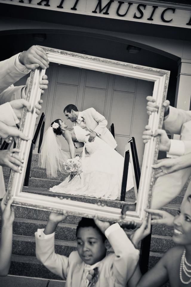 So very cute ~ Wedding party holding the frame.