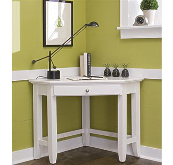When decorating a small apartment (or a small room) don't forget to use corners. A piece of furniture like this could work as an entryway table or a desk.