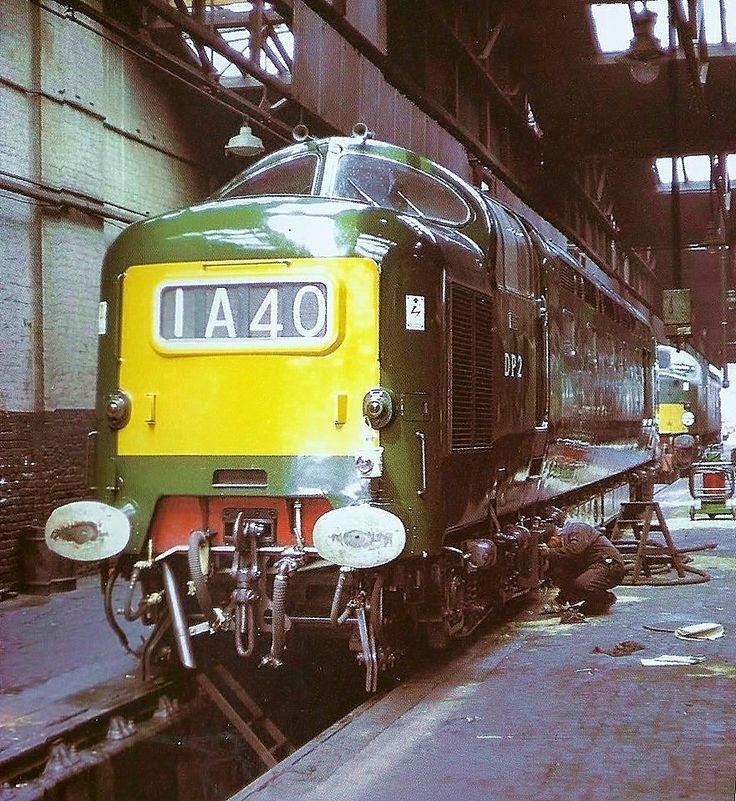 Great shot of DP2 at Camden shed, sometime in 1962. Built by English Electric at the Vulcan Foundry in 1962 using a Deltic bodyshell (reputed to be shell No18). The loco was fitted with an English Electric 16CSVT engine of 2700-hp. On 31 July 1967 DP2 was involved in a serious accident at Thirsk, colliding at speed with the de-railed Cliffe (Kent) to Uddingston (Glasgow) cement train and was withdrawn in Sept 1967 and scrapped in 1970.  (© Via Atlantic)