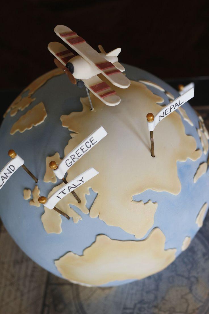 Vintage World globe cake with an orbiting bi-plane