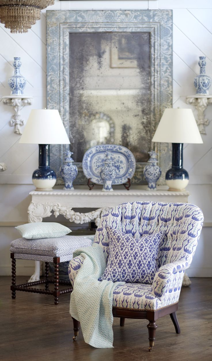 antique furniture upholstered in iris and aqua John Robshaw fabrics, blue and white chinoiserie, blue and white lamps, crystal chandelier, white walls