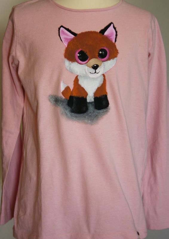 Hand painted girl's t shirt, featuring a plush toy fox. Two rhinestones are attached on the fox's eyes. The colors are non-toxic, water based, permanent fabric colors.