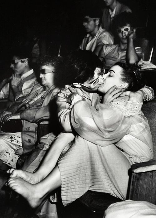 kissing with 3-D Glasses at the Palace Theatre, 1943. Photograph by Weegee (Arthur Fellig).